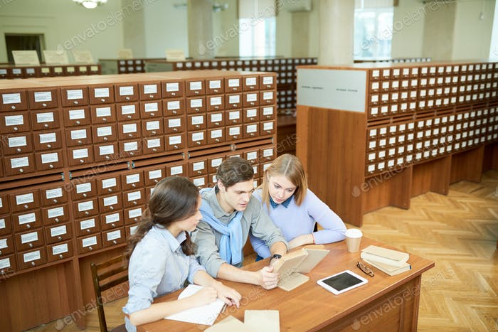 Students getting new knowledge in library