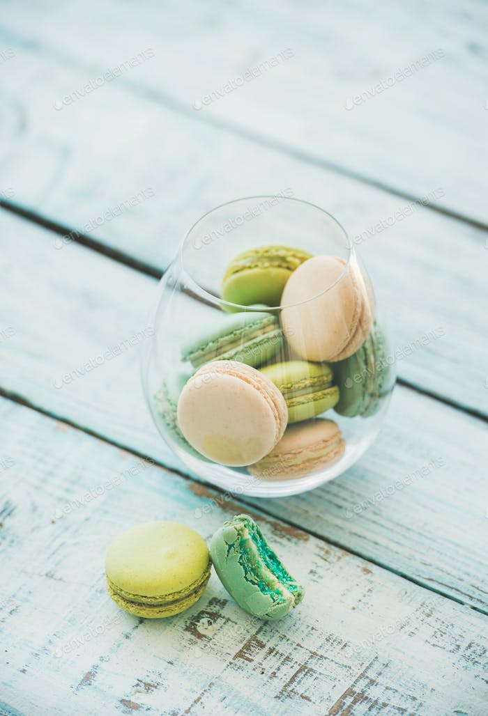 Colorful pastel French macaron biscuits in glass, copy space