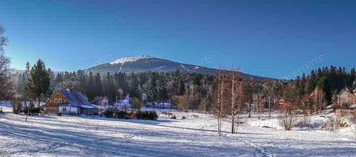 Panoramic view of the winter mountain landscape of Szklarska Por