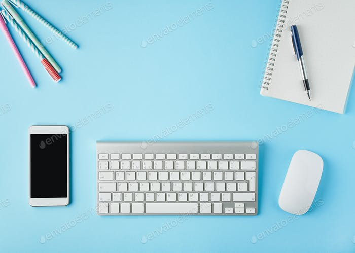 Work from home, online learning. Bright blue modern desk. Top view. Distance education