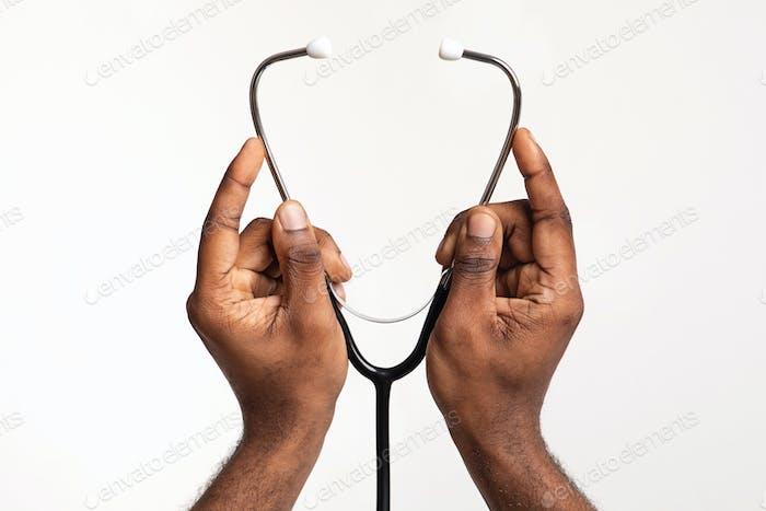 Hands of doctor wearing stethoscope before check up