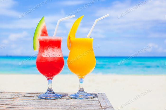 Fresh watermelon and mango cocktails on the background of turquoise sea