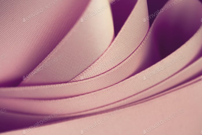 waves of pink satin fabric