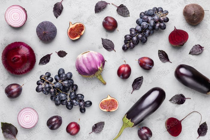 Collection of purple fruits and vegetables on gray background