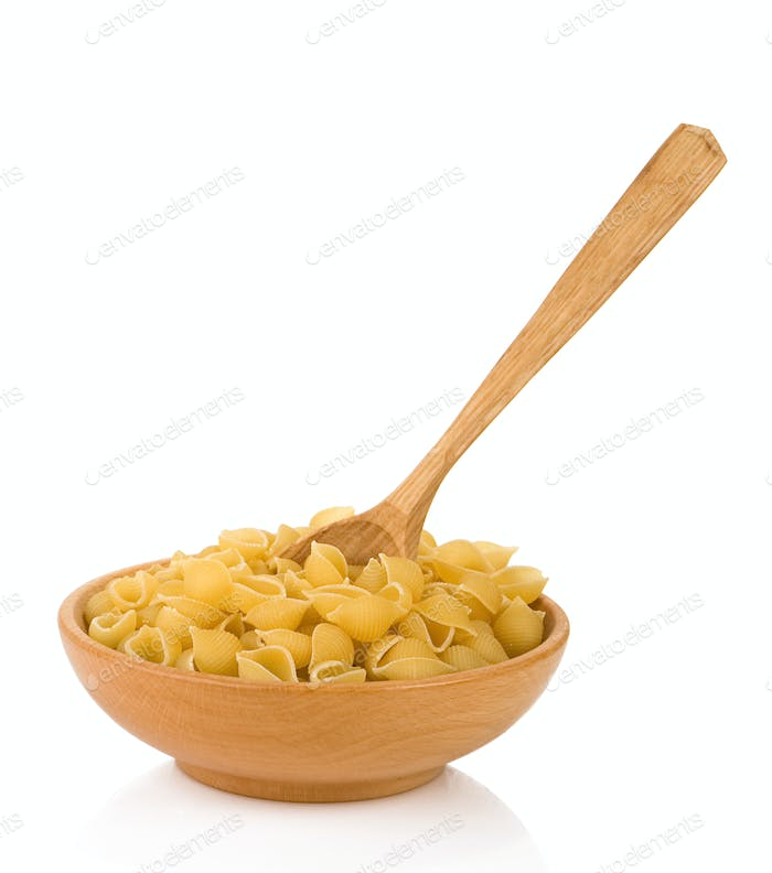 raw pasta and wooden spoon