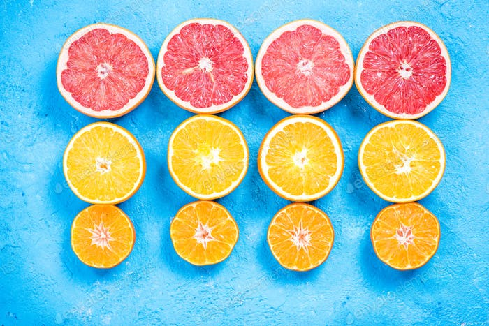 Citrus fruits halves flat lay
