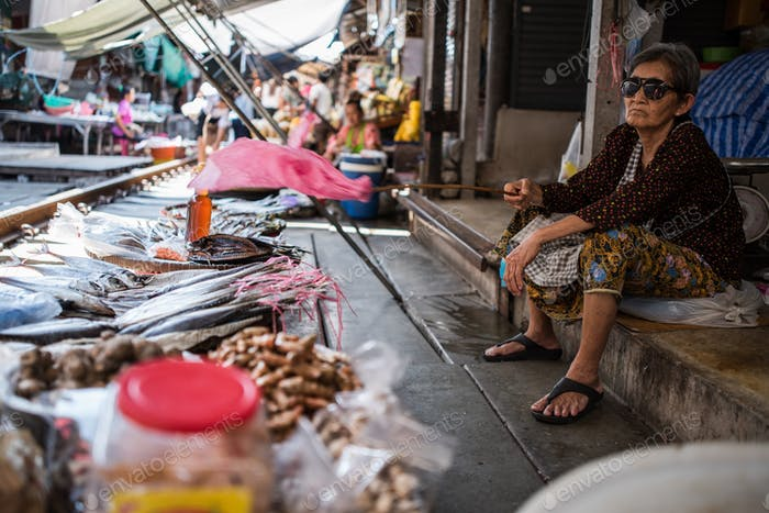 Female vendor at Maeklong market