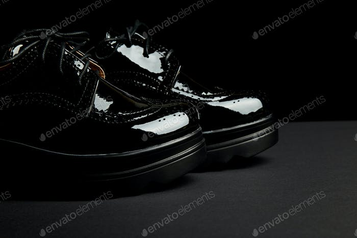 Woman female black oxford platform shoes on black background