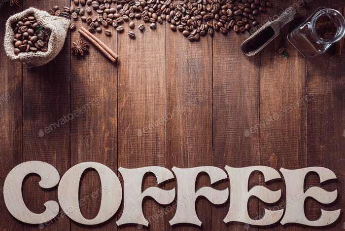 coffee letters and beans on wood