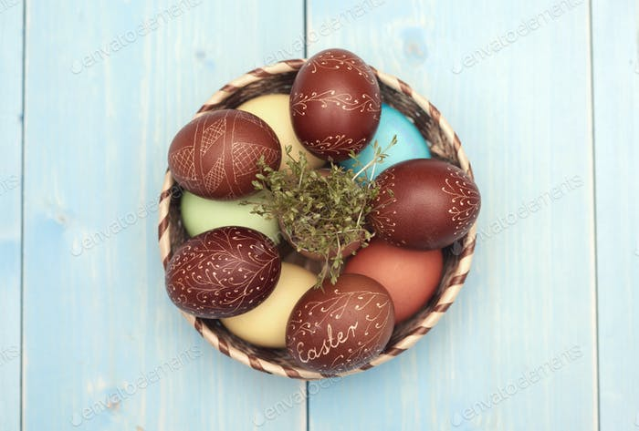 Basket full of carved easter eggs