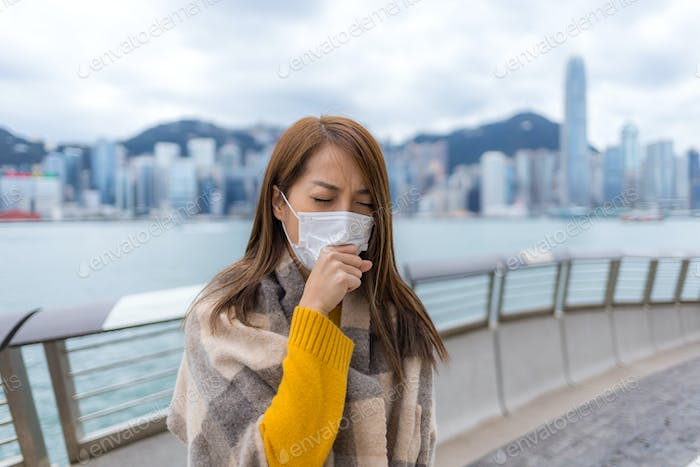 Woman cough with face mask in city