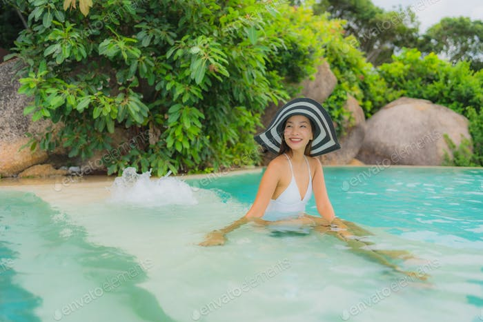 Portrait young asian woman relax smile happy around outdoor swim