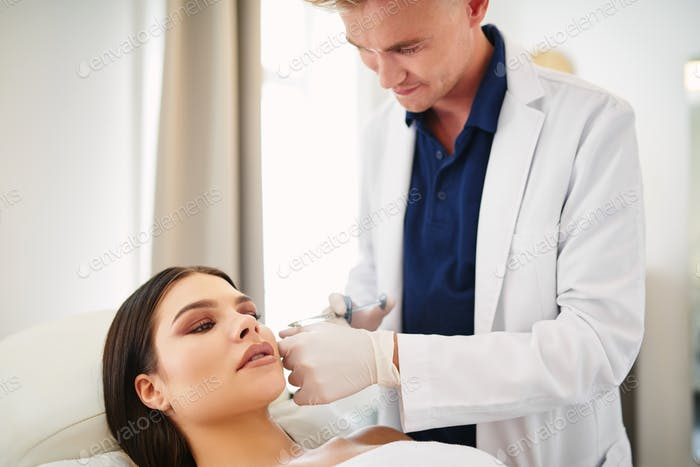 Young woman getting botox injections at a beauty clinic