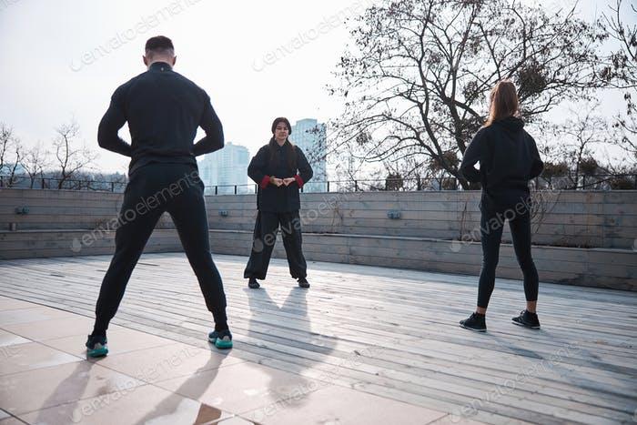 Qigong pose with joined fists by martial artist