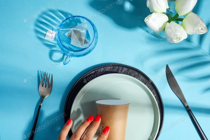 Beautiful table setting and paper cup on a plate. Takeaway restaurant food concept