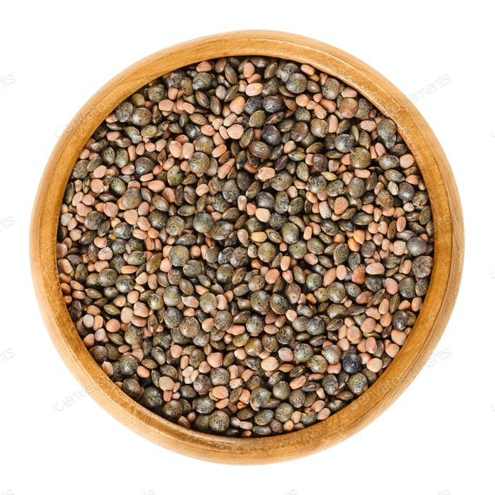 Radish seeds and green lentils in wooden bowl