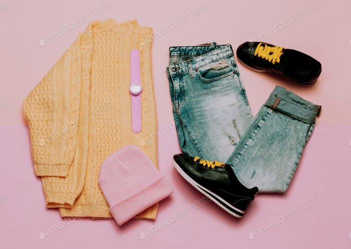Casual outfit for girls. Sweater and jeans. Fashionable accesso