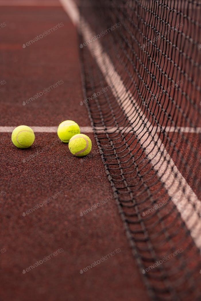 Group of yellow tennis for tennis game by net