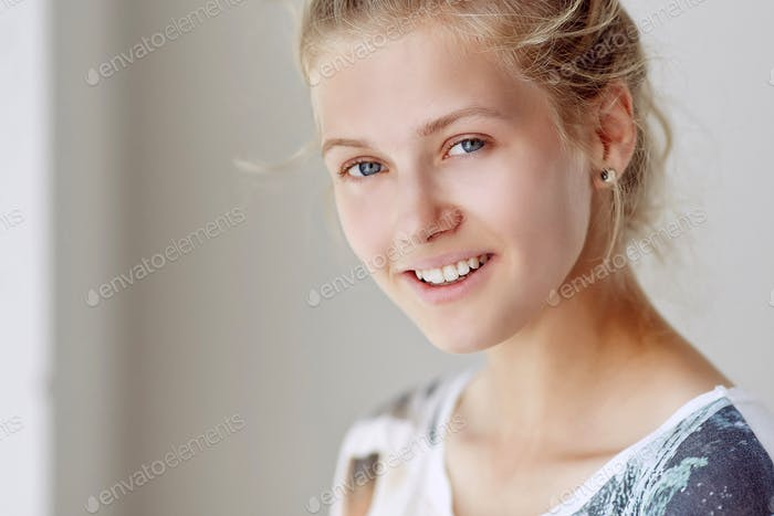 Portrait of smiling blond woman.