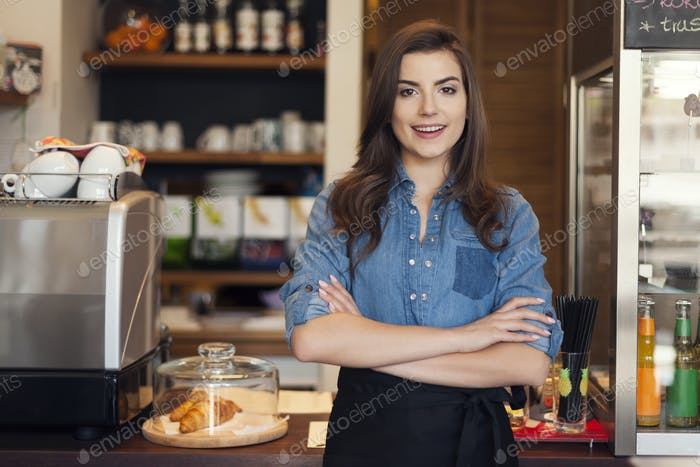 Portrait of friendly waitress at work