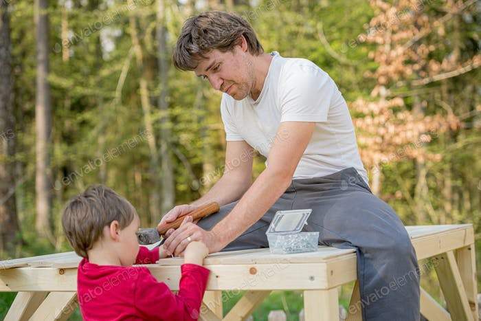 Father and son building play house