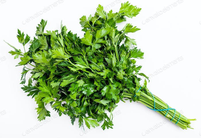 bunch of fresh green parsley herb on white
