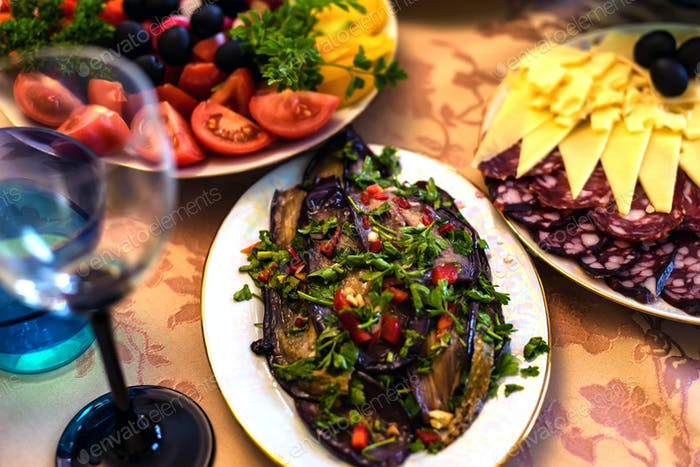 Pickled eggplant in plate on festive table