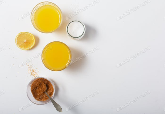Homemade Isotonic Energy Drink and Ingredients. Glasses With Yellow Liquid, Homemade Beverage
