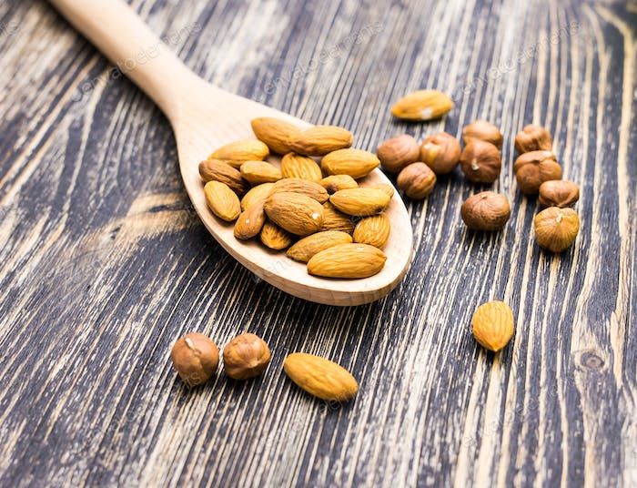 Almonds in wooden spoon