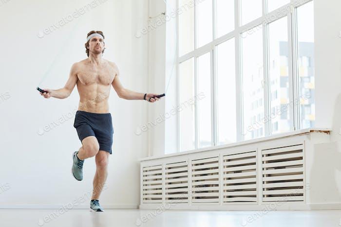 Man jumping on skipping rope