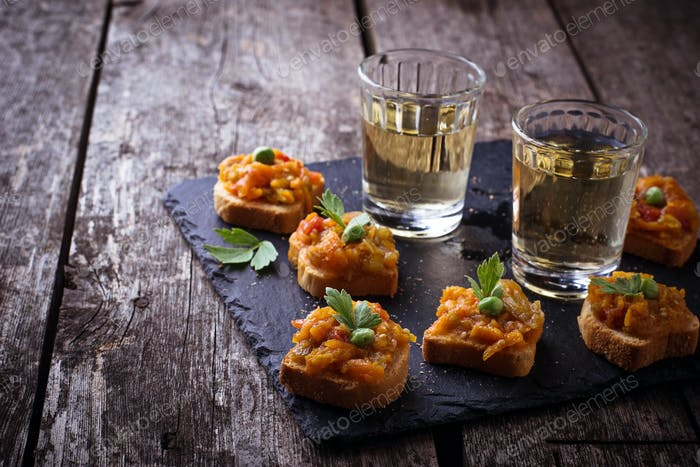 Canape with eggplant caviar and glasses of wine