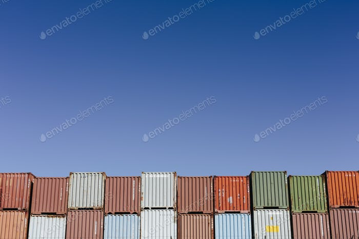 Stacks of multi coloured shipping containers.