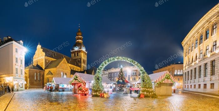 Riga, Latvia. Xmas Market On Dome Square With Riga Dome Cathedra