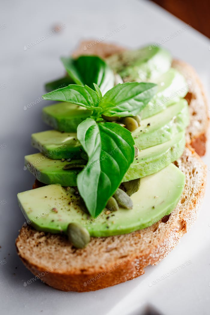 Avocado toast with pepitas and fresh basil