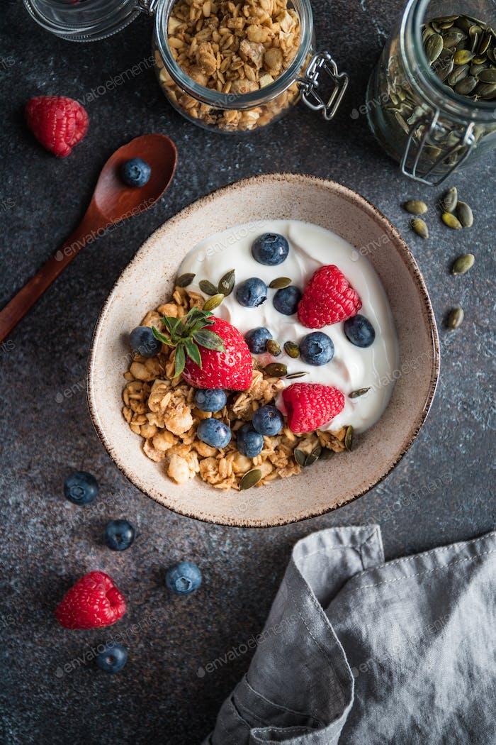 Healthy breakfast, cereal with berries and yogurt