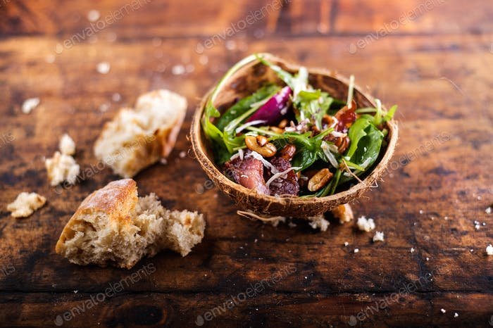 Rucola salad in coconut shell