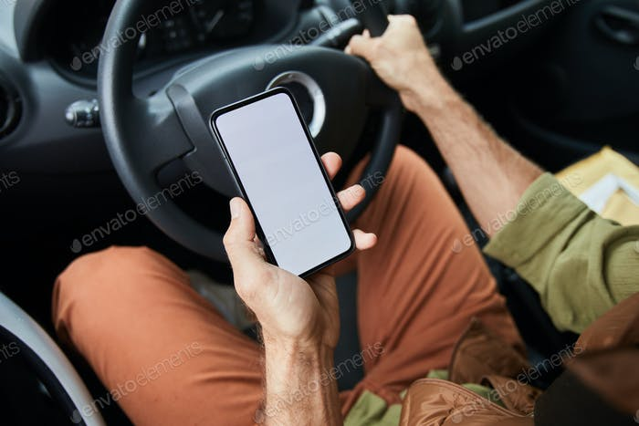 Driver using Smartphone Close Up
