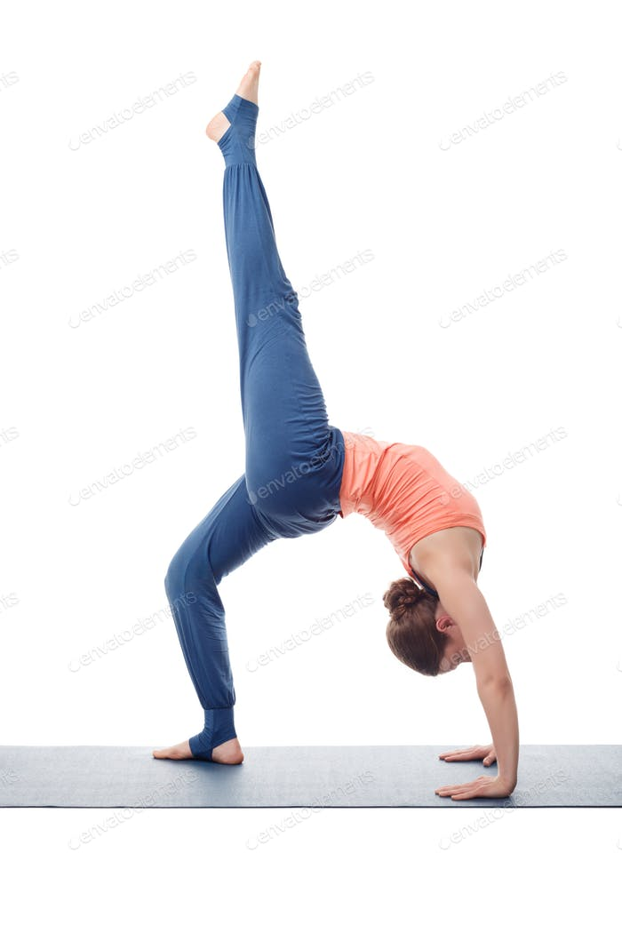 Beautiful sporty fit yogi girl practices yoga asana eka pada cha