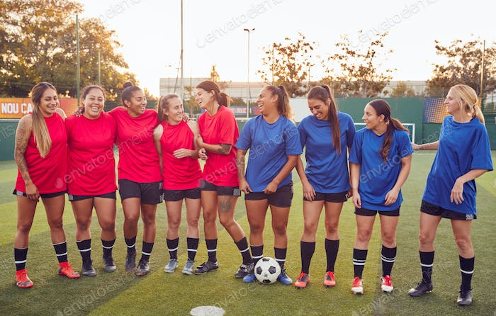 Womens Football Team Hugging After Training For Soccer Match On Outdoor Astro Turf Pitch