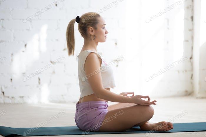 Meditation in sunny room