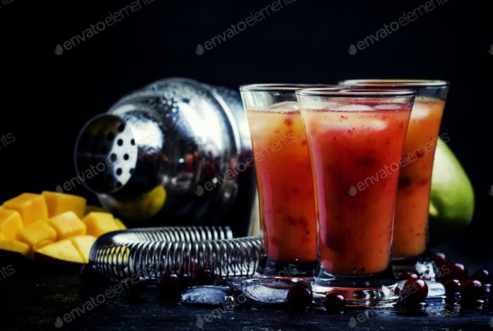 Alcoholic cocktail mango and cranberry liqueur with syrup, juice and ice