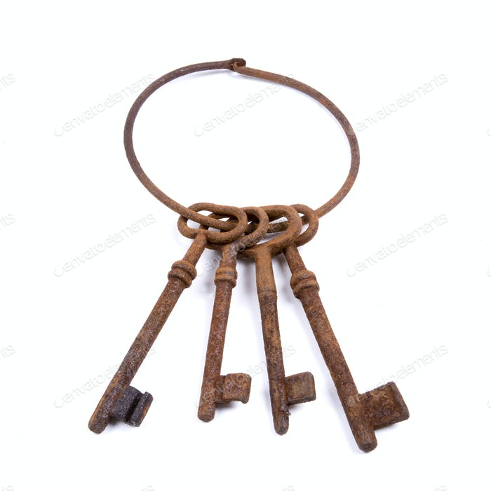 Rusty keys on a white background