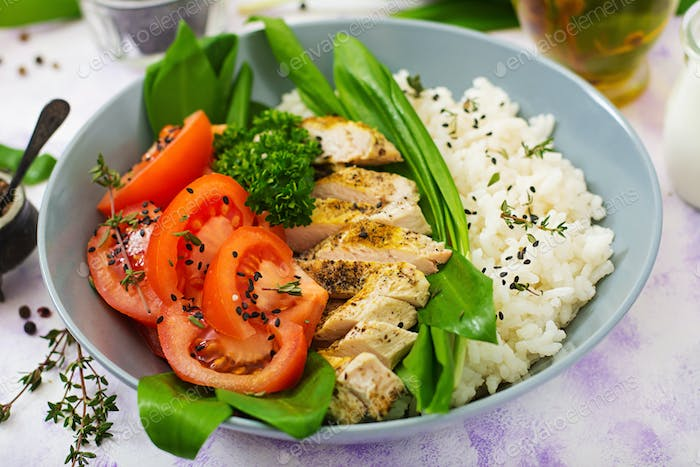 Healthy salad with chicken, tomatoes, wild garlic and rice. Proper nutrition. Dietary menu.