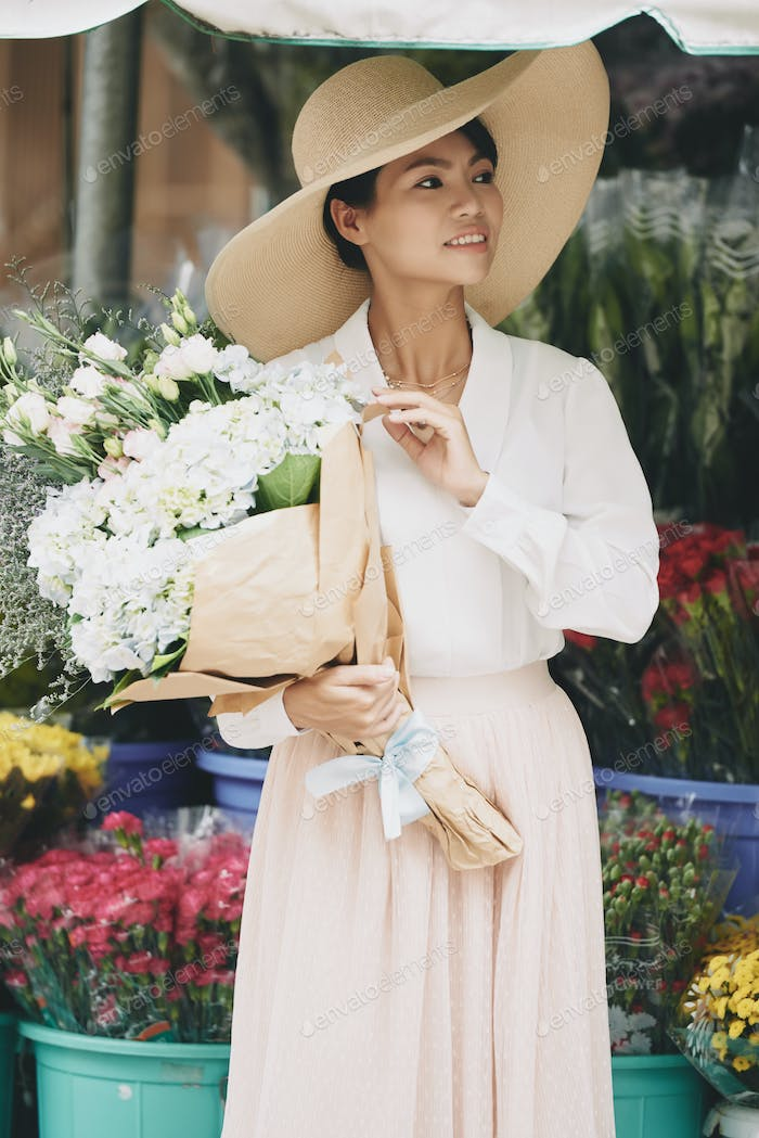 Charming lady with flowers