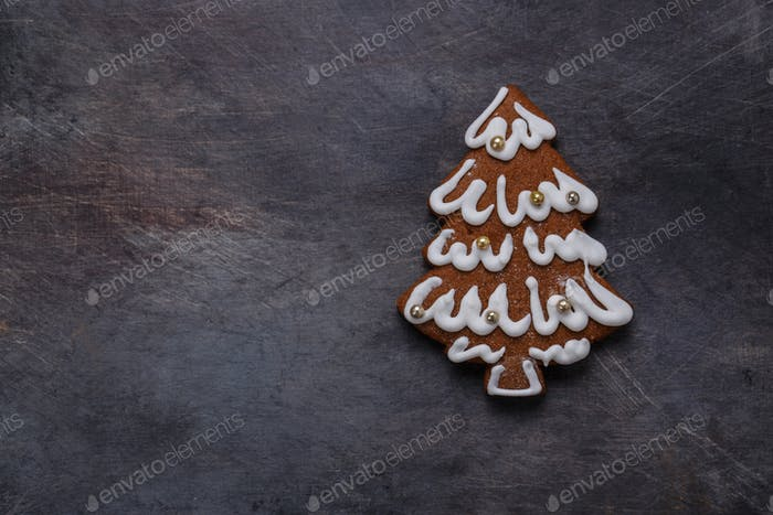 Gingerbread cookies tree on dark background, copyspace