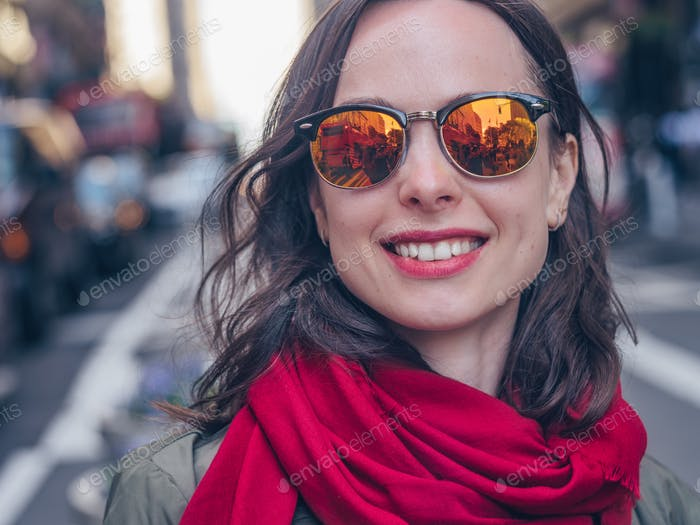 Smiling girl in sunglasses close-up