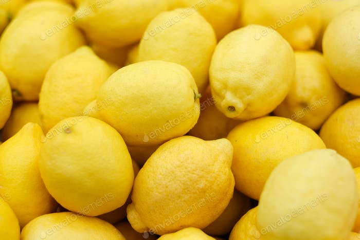 Ripe yellow lemons background