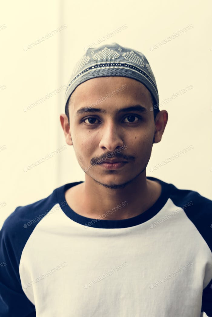 A cheerful muslim man