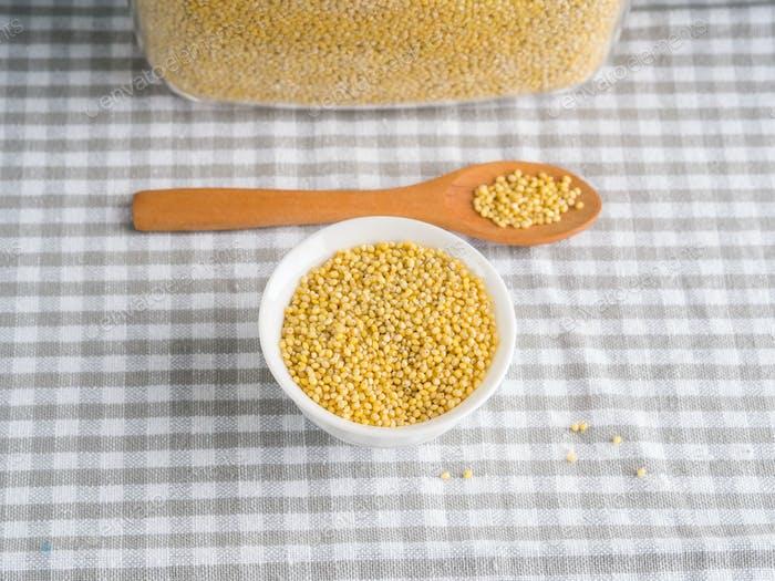Gluten free grain millet in bowl on kitchen table