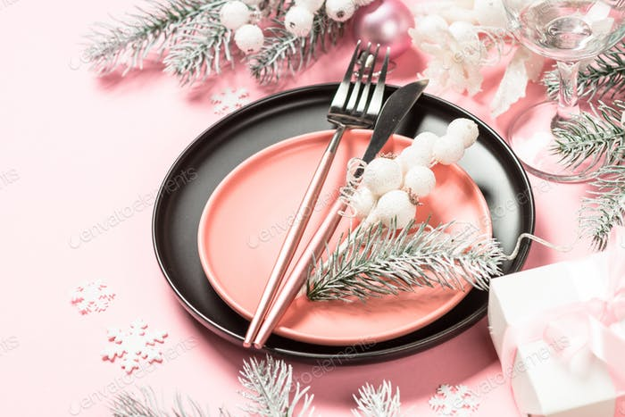 Christmas table setting on pink